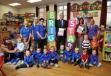 Bloomfield Community Association (BCA) at OFMDFM Bright Start Childcare Strategic Framework with Junior Ministers Jonathan Bell MLA, Jennifer McCann MLA and Playboard's Chief Executive Officer, Jacqueline O'Loughlin.